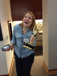 Dallas SWE Secretary Morgen Schroeder has fun posing with one of the many Emmys on display!